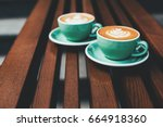 two cups of cappuccino with... | Shutterstock . vector #664918360