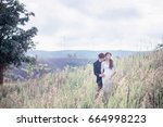 bride and groom  hugging on the ... | Shutterstock . vector #664998223
