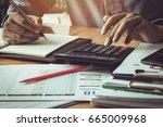 businessman calculating... | Shutterstock . vector #665009968