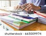 businessman calculating... | Shutterstock . vector #665009974