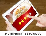 Small photo of Good restaurant review. Satisfied and happy customer giving great rating with tablet on an imaginary criticism site, application or website. Four out of five stars to tavern, cafe or bistro.