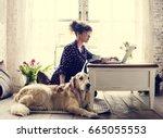 Stock photo woman petting golden retriever dog 665055553
