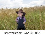 Little Toddler With Cowboy Hat...