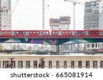 light train passing through... | Shutterstock . vector #665081914