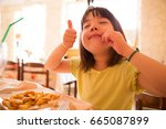young japanese girl happy to... | Shutterstock . vector #665087899