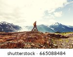 hiking man in canadian... | Shutterstock . vector #665088484