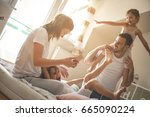 family playing with their two... | Shutterstock . vector #665090224