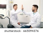 two male dentists in clinic | Shutterstock . vector #665094376