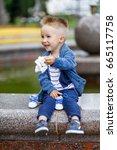 cheerful little boy outdoors   Shutterstock . vector #665117758