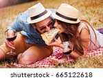 picnic. young couple eating... | Shutterstock . vector #665122618