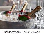 three wine bottles chill in ice ... | Shutterstock . vector #665123620