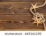 seashells border on wood.... | Shutterstock . vector #665161150