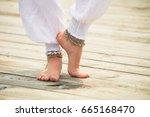 closeup of young woman barefoot ... | Shutterstock . vector #665168470