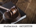 judges gavel on book and wooden