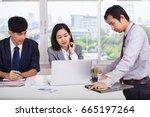 successful asian business team... | Shutterstock . vector #665197264