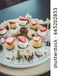small colorful cakes with... | Shutterstock . vector #665202853