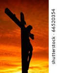 Holy cross at the sunset - stock photo