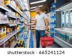 african man shopping in... | Shutterstock . vector #665241124