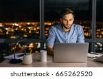 young businessman working on a... | Shutterstock . vector #665262520