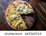 homemade pizza with seafood and ... | Shutterstock . vector #665265214