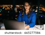young businesswoman working on... | Shutterstock . vector #665277586