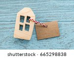 wood house and blank paper tag... | Shutterstock . vector #665298838
