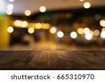 empty wooden table in front of... | Shutterstock . vector #665310970