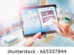 a businesswoman selecting a... | Shutterstock . vector #665337844