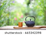 black vintage teapot and cup at ... | Shutterstock . vector #665342398