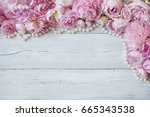 Stock photo pink peonies and roses on a wooden background 665343538