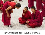 Small photo of Lhasa, China - May 03, 2012: Unidentified buddhist monks debate at Sera monastery, Tibet. Debating is part of the monastery educational program to become a higher lama.