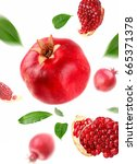 pomegranate with slice and leaf ... | Shutterstock . vector #665371378