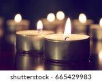 candles lights on dark... | Shutterstock . vector #665429983