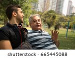 dad and son having fun in the... | Shutterstock . vector #665445088