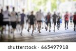 marathon runners in the city  | Shutterstock . vector #665497918