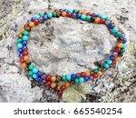 colorful bead stones 7 chakras...   Shutterstock . vector #665540254