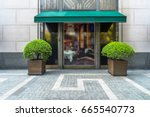 shopfront with large windows | Shutterstock . vector #665540773