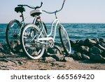 two retro bike on the beach...   Shutterstock . vector #665569420