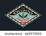 badges exclusive spark plug.... | Shutterstock .eps vector #665573503