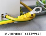 yellow ground cable with ring... | Shutterstock . vector #665599684