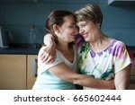cute young woman and her mother ... | Shutterstock . vector #665602444