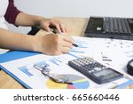 business holding a pointing pen ... | Shutterstock . vector #665660446