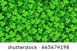 clover leaves background.... | Shutterstock .eps vector #665674198