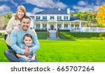 mixed race family in front yard ... | Shutterstock . vector #665707264