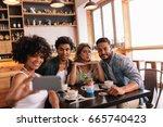 young men and women sitting... | Shutterstock . vector #665740423