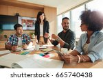 young people during meeting in... | Shutterstock . vector #665740438