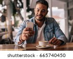 indoor shot of young man... | Shutterstock . vector #665740450