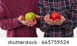 Hand With Red And Green Apple....