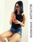 sexy girl in short jeans  shirt ...   Shutterstock . vector #665762758