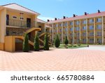 two and four story motel.... | Shutterstock . vector #665780884